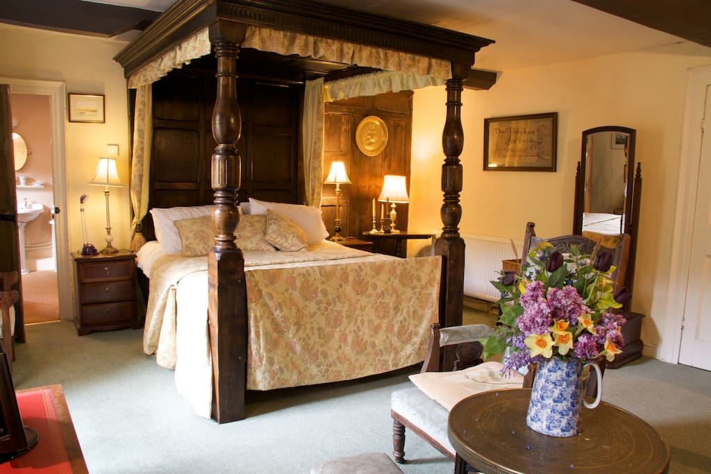 Cosy Elizabethan room with original fireplace and beams and a large vintage style bathroom.