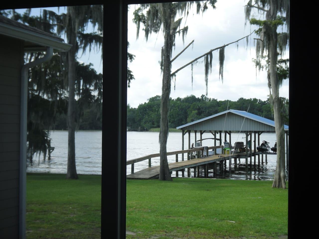 Oversized covered dock on river