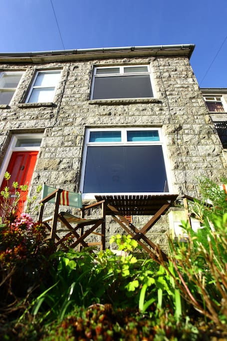 Traditional granite cottage with picture windows to make the most of the view