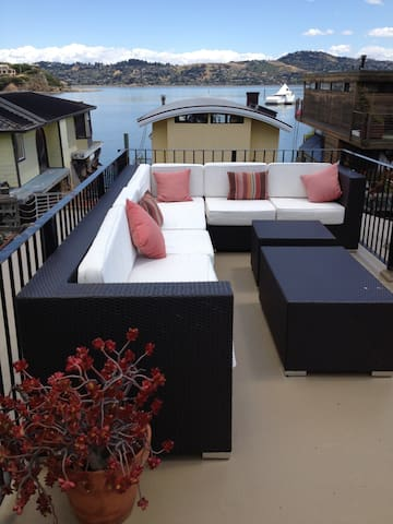 Comfy couches on roof deck with views of Marin County and San Francisco