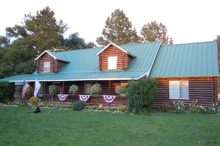 "Log Cabin on 17 Acre Farm with backyard ""Playland"""