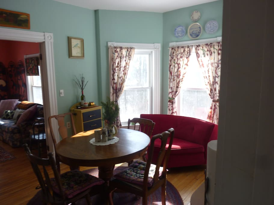 The dining room, couch and window view.