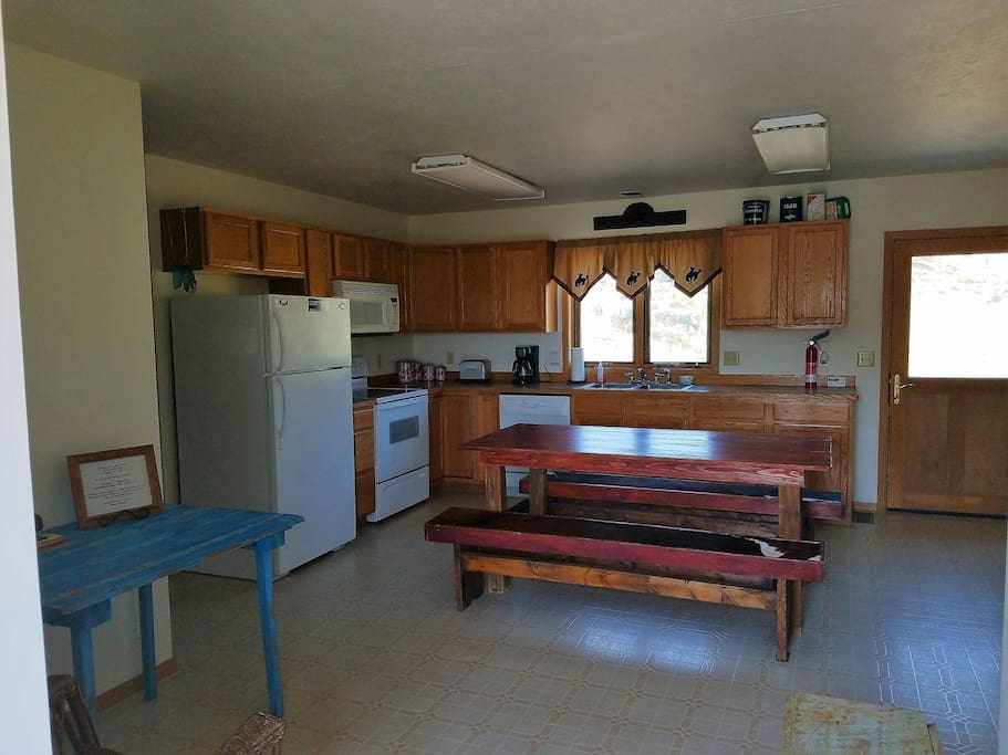 Fully equipped kitchen on main level.  Stove/oven, refrigerator, microwave, dishwasher, coffee pot, toaster, pots and pans, dishes. Table seats 6.
