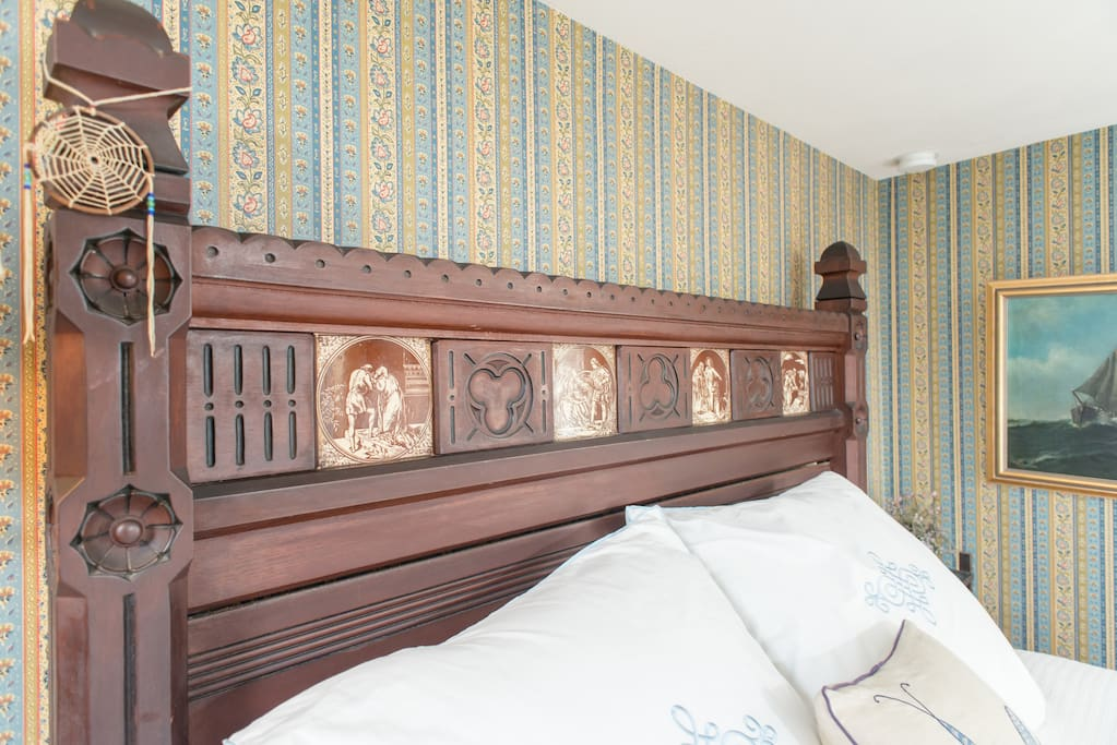 The tiles in the head board represent different stories.... can you identify the stories?