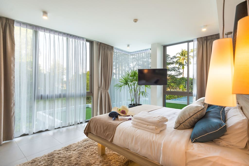 Bedroom with air conditioning and TV