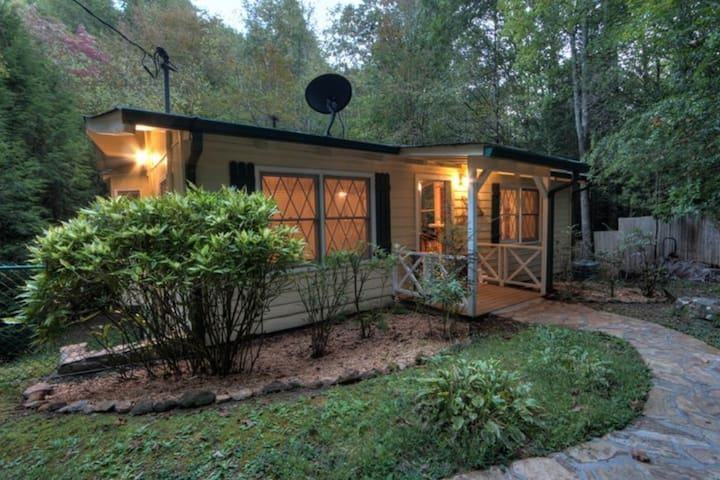 Dog-friendly, waterfront cabin with a private hot tub in a peaceful location