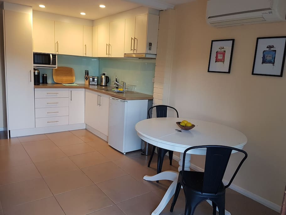 Good size kitchenette with dining table