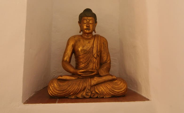 Buddha statue in bedroom
