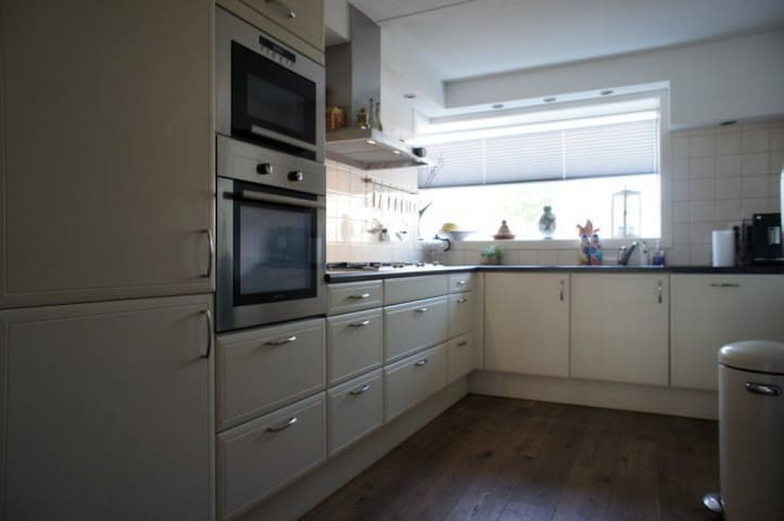 Kitchen with oven, gas range, microwave, and dishwasher