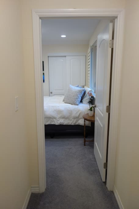 This comfy, bright room offers privacy with all the house amenities just downstairs.