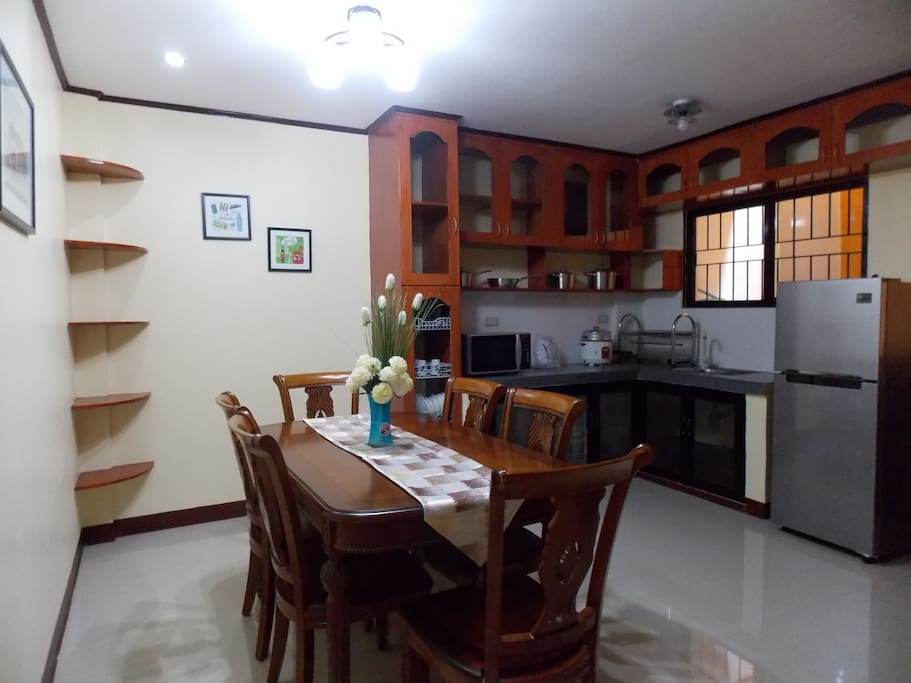 Big Dining room with Microwave oven, Frigidaire, Induction Cooker, 6 seat Dining table, Utensils & Cooking ware, Plates etc.