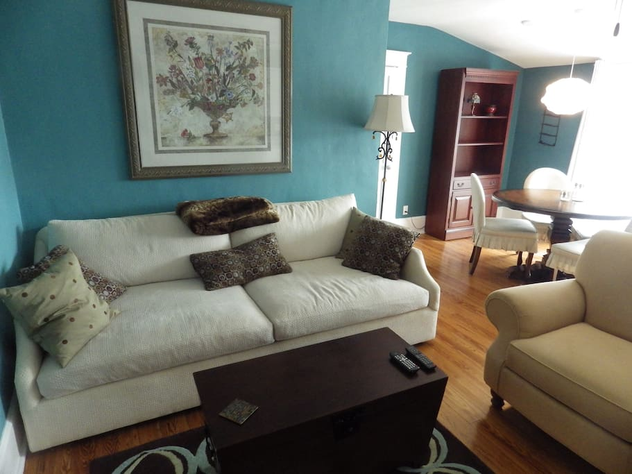 Very comfortable living room with LCD TV/DVD player and music speakers for Ipod/Mp3 player.