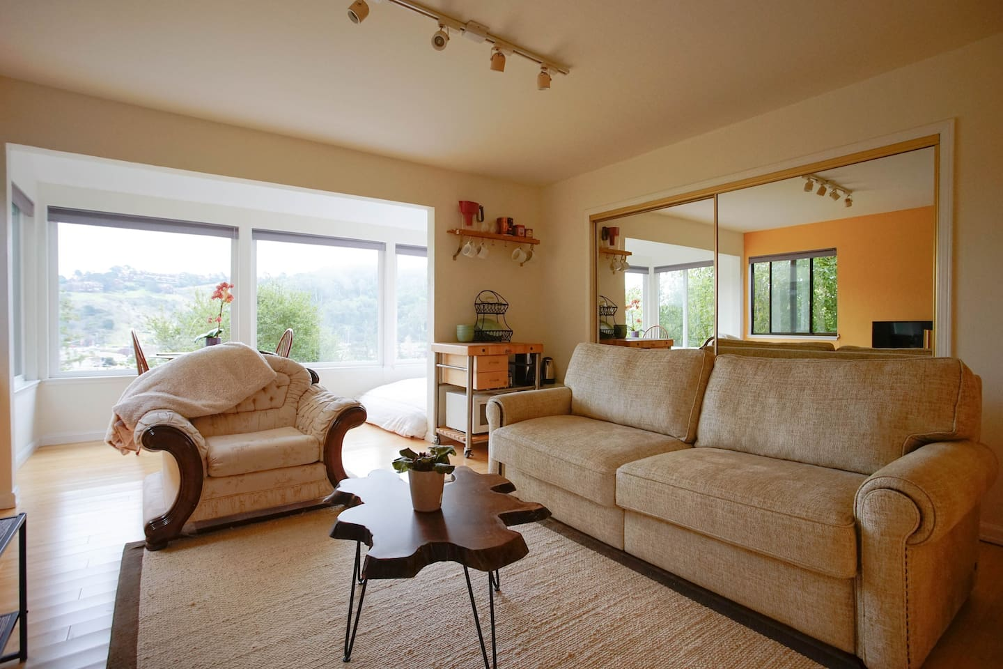 This is the living room. You'll see behind the chair a small dining area and the reading nook om
