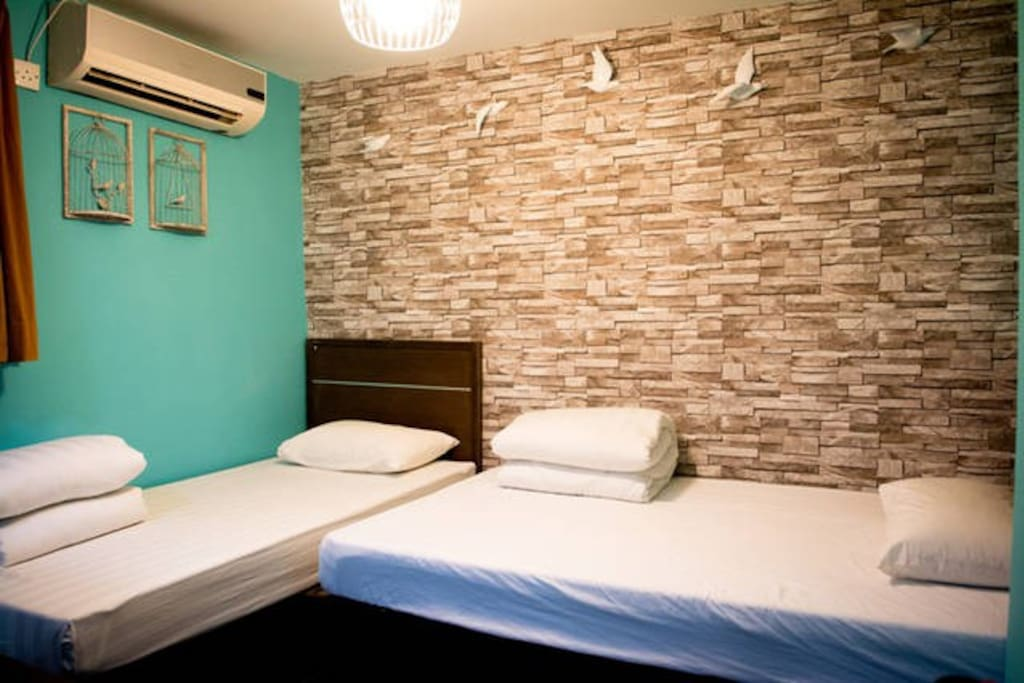 Our Bird Cage room in warm turquoise color provides one Double Bed and a Single Bed perfect fit for 3 person