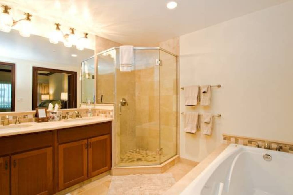 Large bathrooms, travertine tile and Jacuzzi tubs