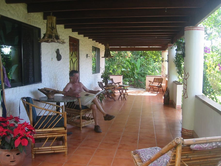 Guests patio to relax with view of ocean and pool at sunset and private entrance.
