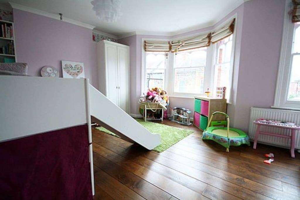 Large kids/teenagers room. 2 single beds (full length) ideal for kids/teenagers with a slide for added fun. Max weight restriction (6 stone) on slide, but regular weight limit for the 3 stairs to top bunk. Well lit and beautifully decorated.