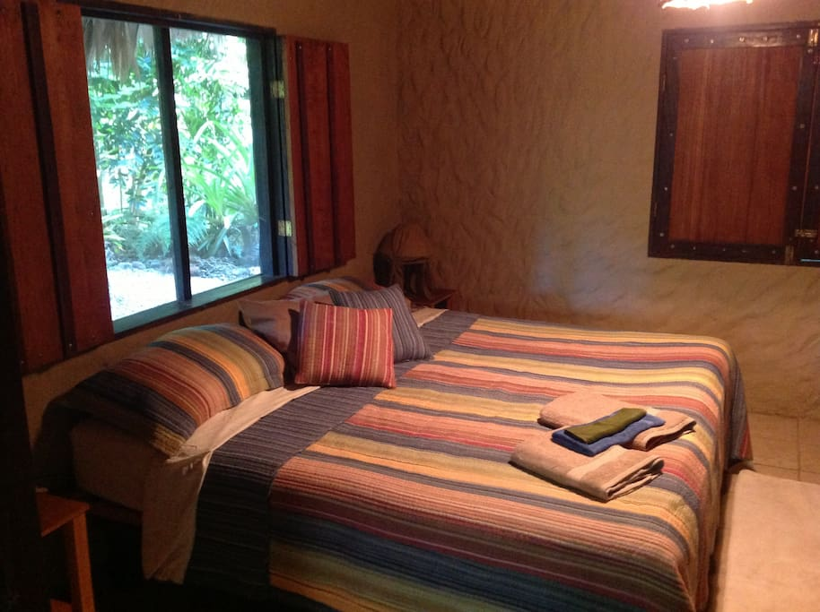 Bedroom features an enormous Kingsized bed...