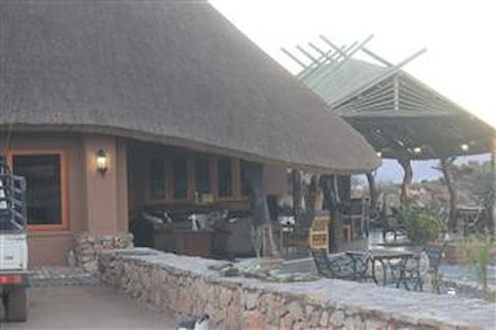 Lodge Reception and dining area with bar that have a beautiful view over the plato!