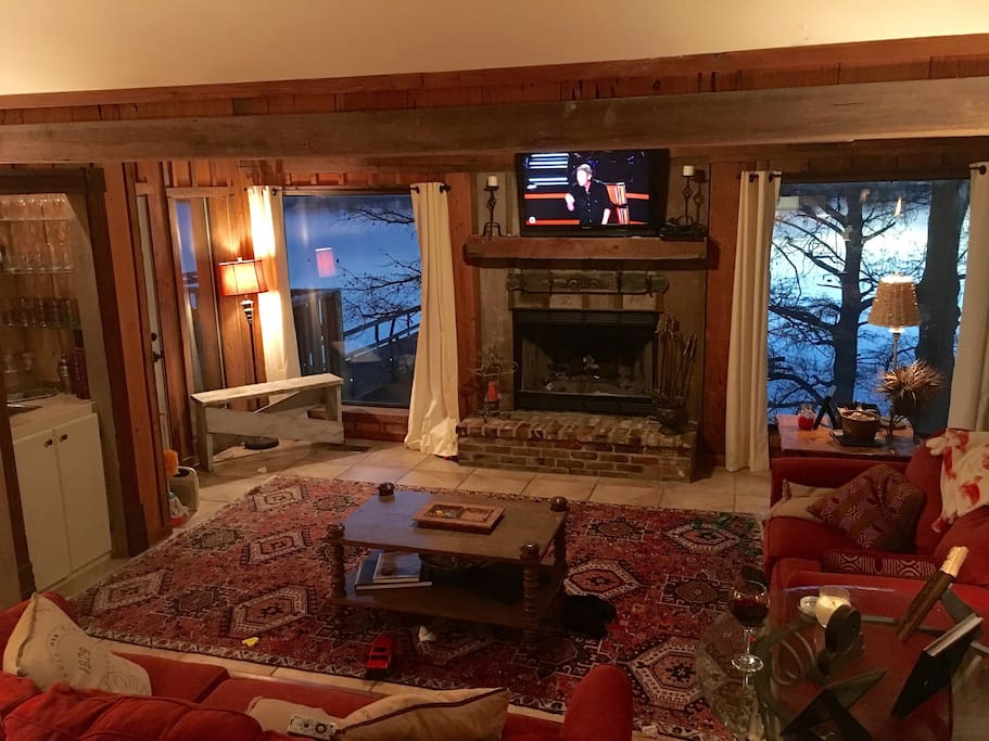 Den with Fireplace! We have a great view of the lake from every room!