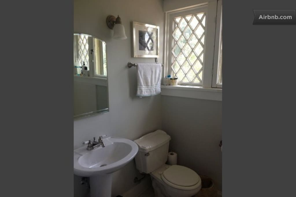 The upstairs bath room with shower and bath