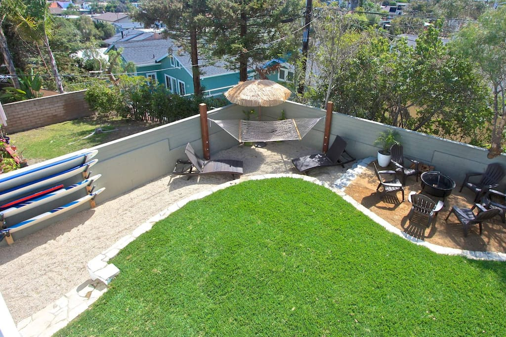 Back yard with new landscaping, BBQ, hammock and plenty of lounging area