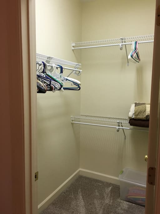 Tons of storage in walk in closet.