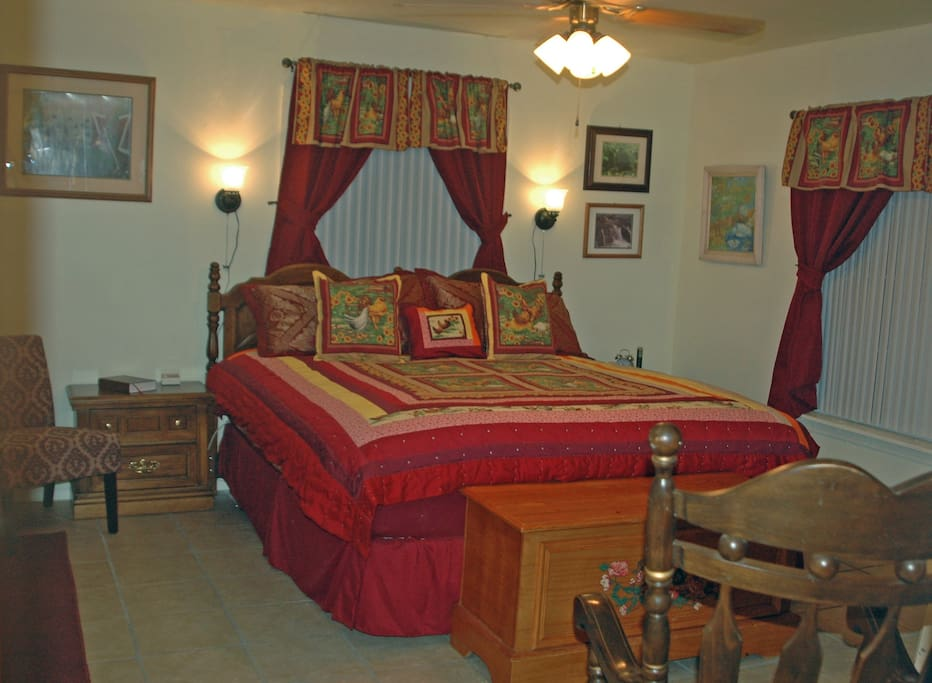 Master bedroom with King sized bed and furniture.
