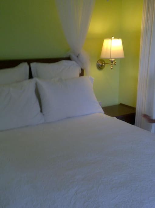 Smaller Bedroom with Queen Bed and verdant valley view!
