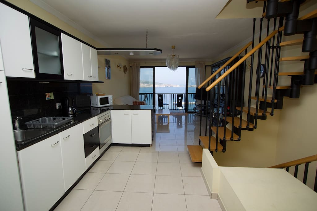 Aqua Kitchen, Lounge and Lower Balcony overlooking St. Paul's Islands & Beyond