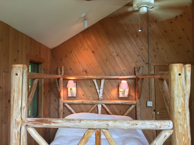 Upstairs Queen Bedroom has a wonderful bed and vaulted ceilings.