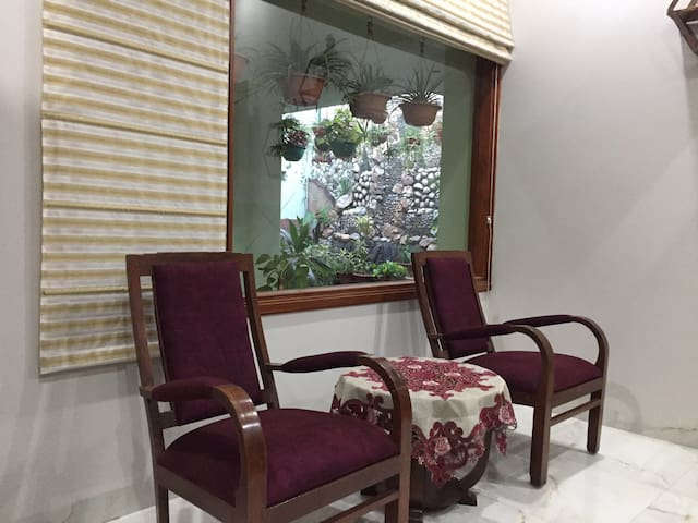 Wake up to the view of greenery & ample morning light right from the comfort of your bed @ the Fine Cottage Homestay Amritsar.
