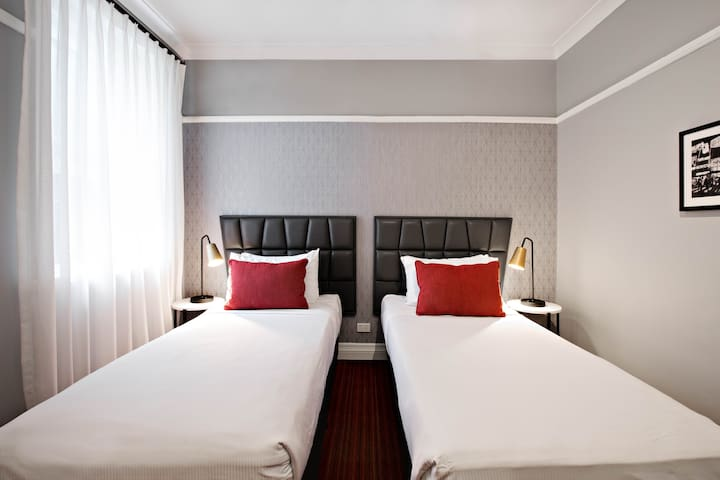 Rooms feature two single beds.