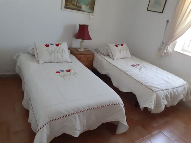 Double room two single beds with TV air conditioning hot and cold,  coffee maker, view of pool, mosquito nets, private bathroom and wc