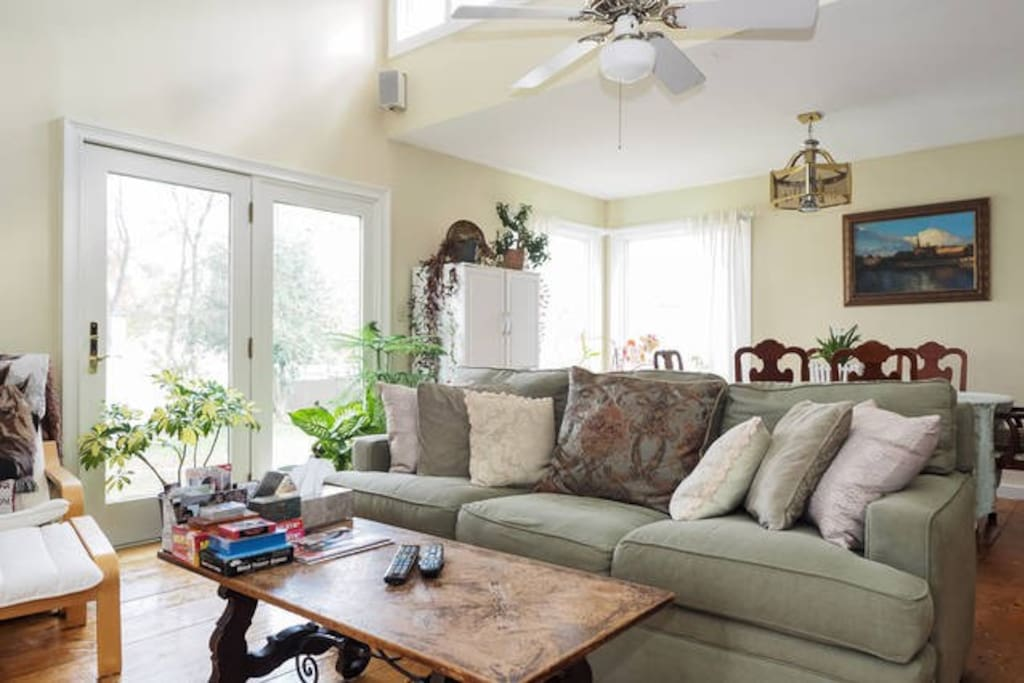 Enjoy our warm, sunny family room with flat screen large TV
