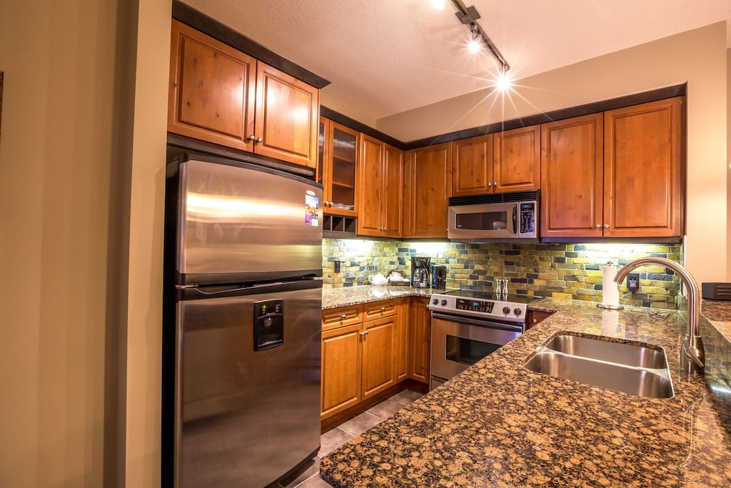 The kitchen is a pleasure to cook in, with high-end appliances and sleek finishings