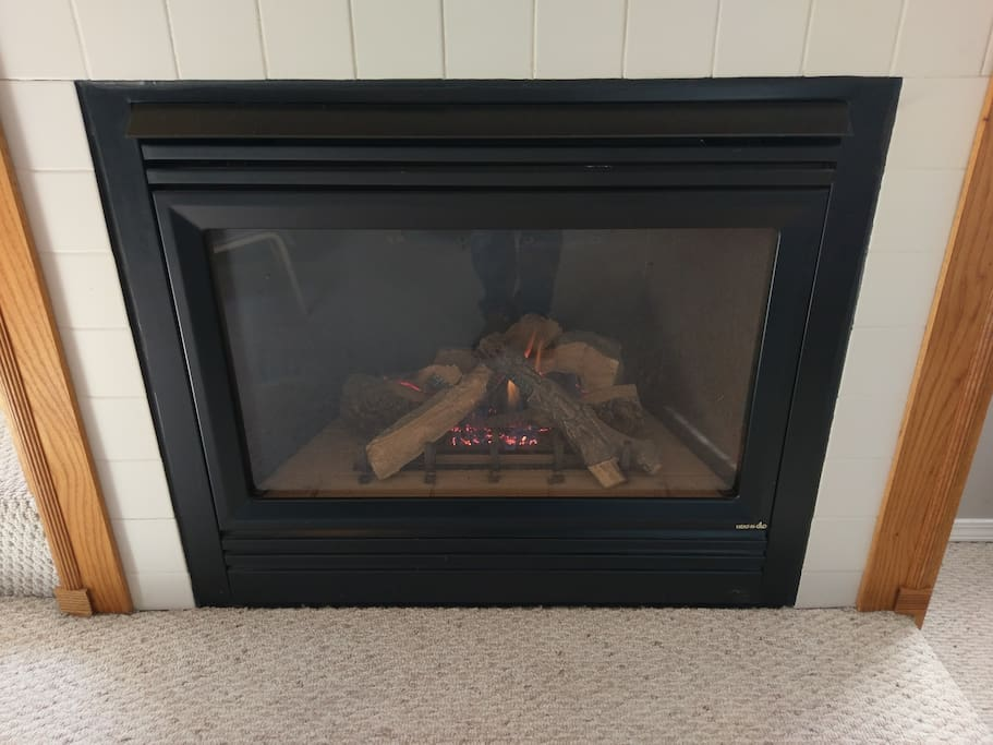 Gas fireplace with wireless thermostat remote and blower. Wonderful natural heat on a winter night!
