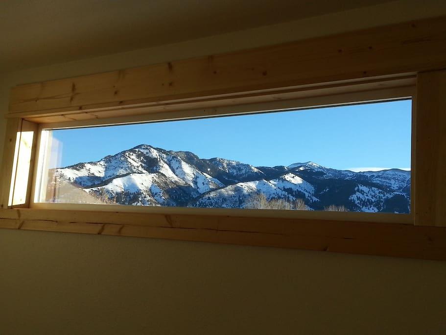 Upstairs bedroom windows frame beautiful mountain views