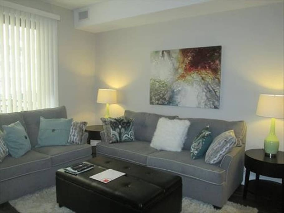 Comfortable living room with pullout sofa bed and club chair
