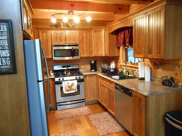 Kitchen with fridge, dishwasher, and gas range