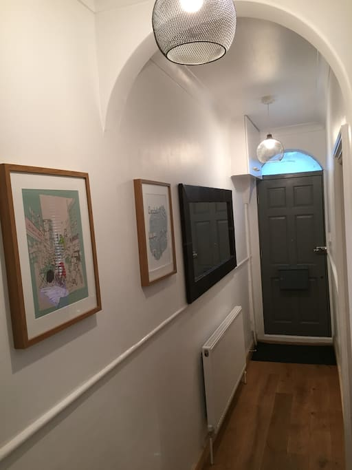 Hall with large mirror and pictures.