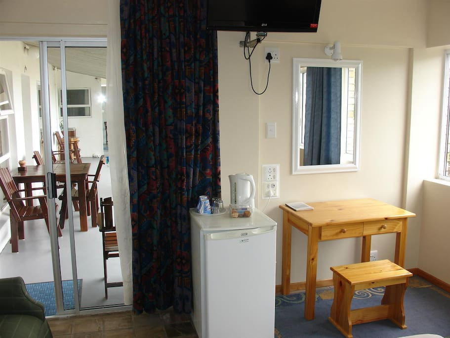 desk, fridge, coffe and tee facilities