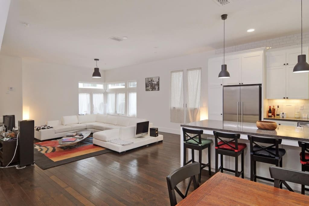 Living room and kitchen island plus dining area.