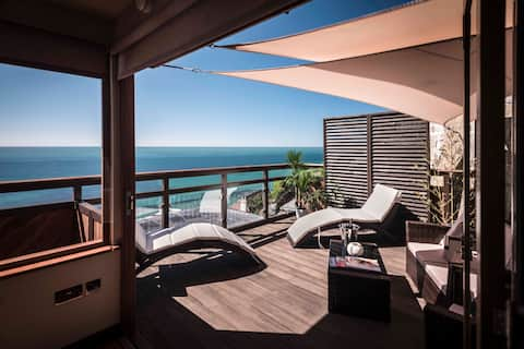 Enjoy your own private south facing deck overlooking the sea.