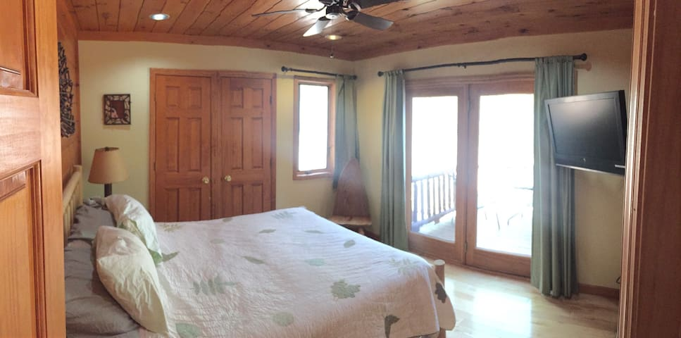1st flood bedroom with tv (streaming only), ceiling fan, and private deck.