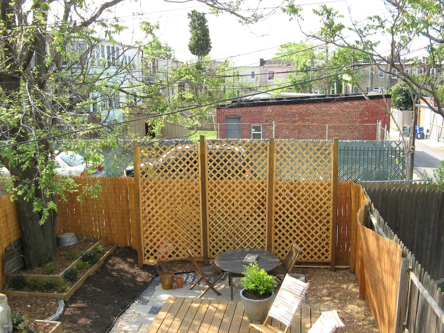 We've added a large patio table with an umbrella to the back yard, plus a blueberry and raspberry bush and a few herb pots.