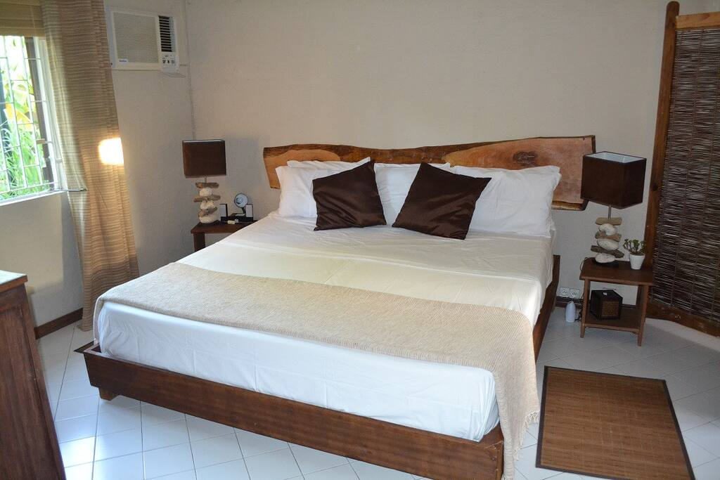 thi is your new room: the deluxe room with handmade natural wood and wooddrift decorations made by us and a 2mx2m bed
