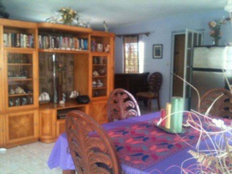 Dinning table seats 5 / home entertainment separates sleeping quarters from living quarters.