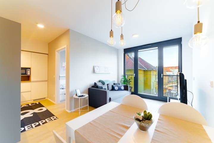 Living room with dinning area and kitchen, view of the city