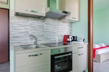 The equipped Kitchen with the coffee machine, the kettle & the welcome kit